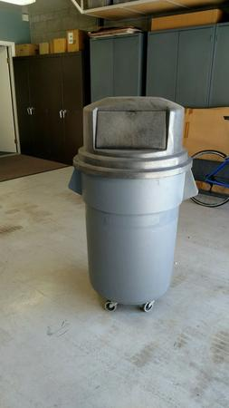 Rubbermaid BRUTE 55 Gallon Waste Container with wheeled doll